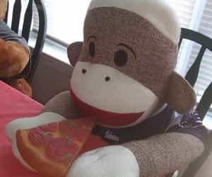 pizza, stuffed animals, and Sock Monkey image