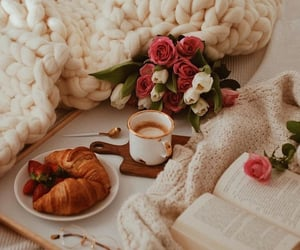 book, croissant, and flowers image