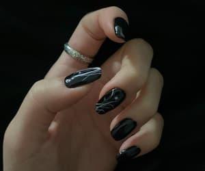 nail art, black nail polish, and silver ring image
