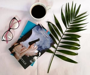 book, glasses, and plant image