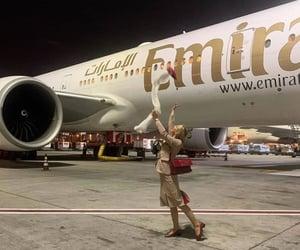 air hostess, emirates, and flight attendant image