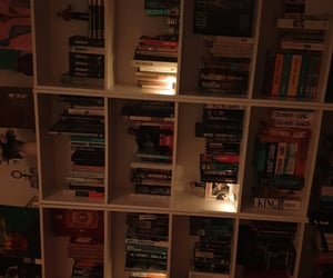 bookshelves, candles, and decor image