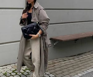 sneakers and trench coat image