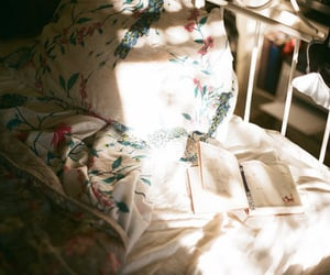 bed, book, and analog image