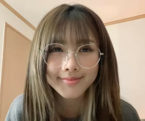 dreamcatcher, blonde highlights, and glasses image