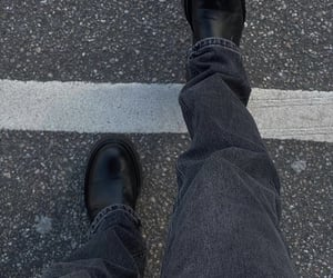 black boots, wide leg jeans, and straight leg image