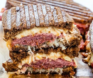 a reuben sandwich cut in two and stacked