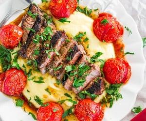 polenta, roast tomato, and grilled steak image