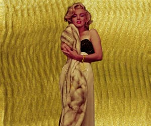Marilyn Monroe, mink, and gold backdrop image