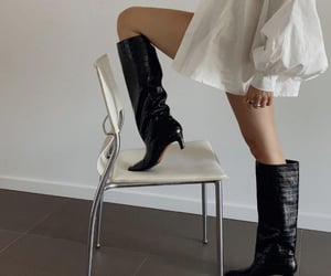 puff sleeves, knee high boots, and button up dress image