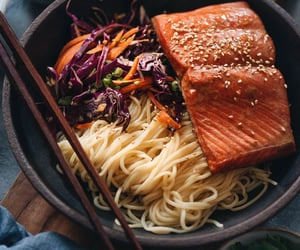 30-Minute Salmon Noodle Bowl with Coleslaw - Tender flaky juicy baked salmon served on noodles with coleslaw in a garlicky gingery savory sauce that's lightly sweet. This recipe uses a blender to mix one sauce that is used as the salmon marinade and in th