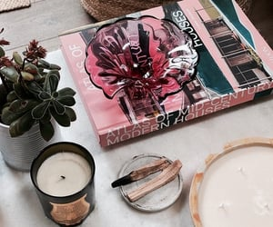 book, candles, and decor image