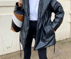 black jacket, black leggings, and blogger image
