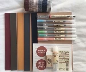 collection, notebook, and pens image