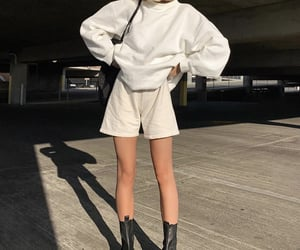 white shorts, white sweater, and everyday look image