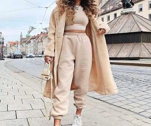 wheretoget.it • @wheretoget missy empire Remy Cream Faux Fur Midi Oversized Coat