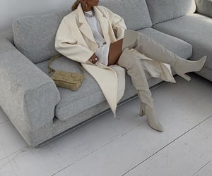 knee high boots, white dress shirt, and beige coat image