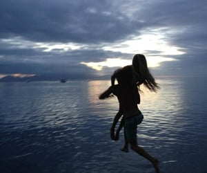 couple, jumping, and nature image