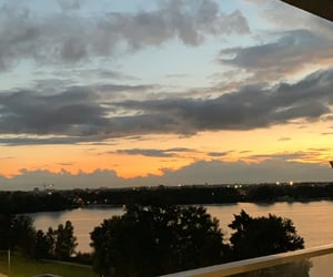 calm, lake, and sunset image
