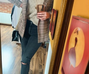 ankle boots, jumper, and ripped jeans image