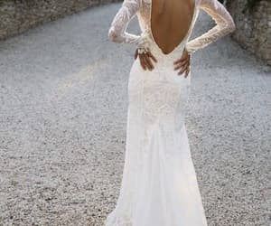 bride stunning dress and lace long sleeve low cut image