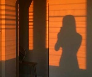 shadow, girl, and orange image