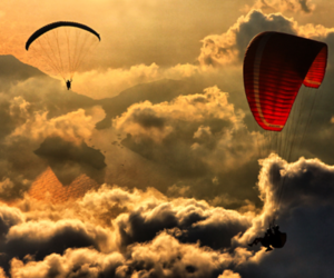 sky, clouds, and parachute image