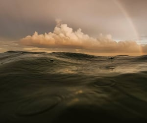 clouds, ocean, and rainbow image