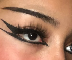 cateye, eyeliner, and goth image