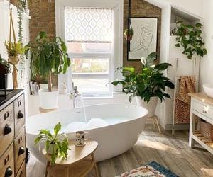 bathroom, plants, and bathtub image