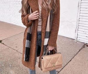 blue jeans, scarf, and tan jacket image