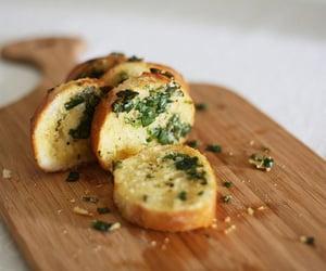 food, garlic bread, and bread image