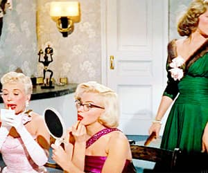 Betty Grable, Lauren Bacall, and gif image