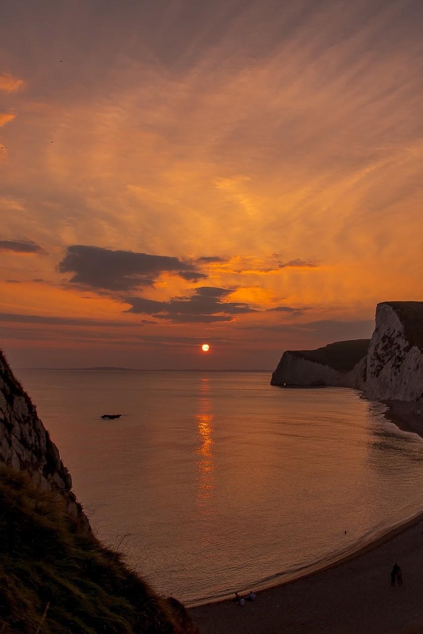 sunset, sea, and sky image