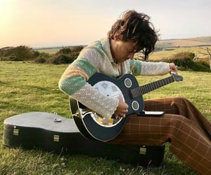 Harry Styles, vogue, and guitar image