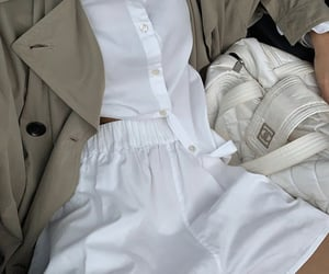 white shorts and beige trench coat image