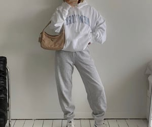 grey sweatpants, white hoodie, and graphic top image