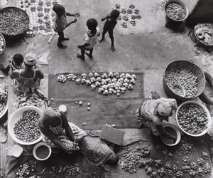adanvc:  Market in Abidjan, 1969.  by Paul Almasy