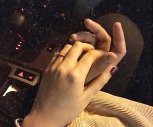 holding hands, hand hands, and عناقك عناق image
