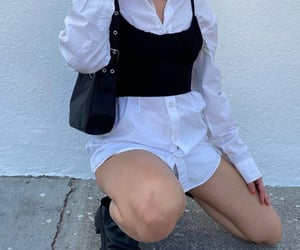black boots, black crop top, and classy glam image