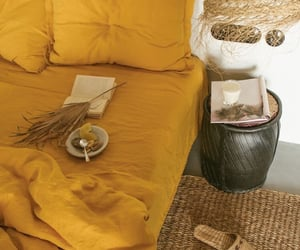 Turmeric 100% Flax Linen Bedding Set Add sunshine and warmth to your bedroom with our golden Turmeric linen sheets.  Here they are styled beautifully with a minimal bedside table, geometric table lamp and ceramic vase with dried flowers. | Bed Threads Pin