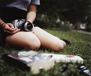 camera, book, and grass image