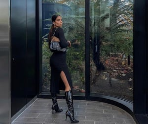 backless dress, prada bag, and knee high boots image