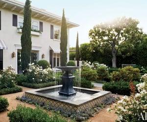 fountain, white house, and garden image