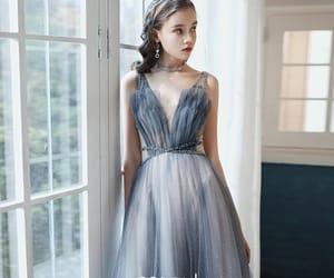 girl, long dress, and deep v neck dress image