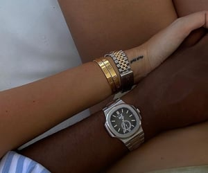 holding hands, Relationship, and rolex image