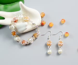 elegant, handmade jewelry, and orange jade image