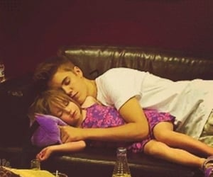 8 year old Evie Potter and 15 year old Teddy Lupin on the couch at Andromeda Tonks's house taken by Ginny Potter (nee Weasley) when she came to pick the two up.