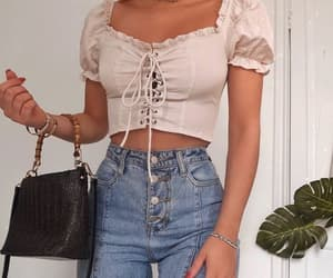 blouse and high waisted jeans image