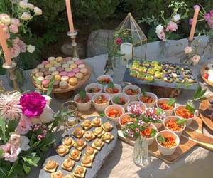 candles, flowers, and food image